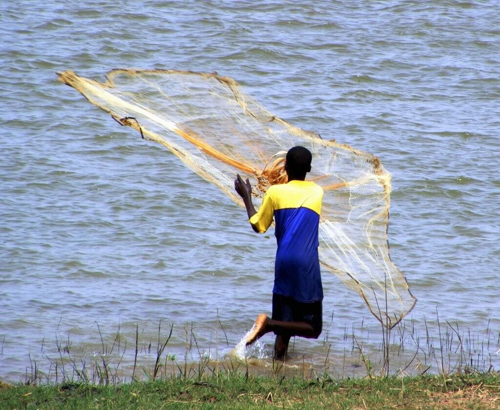 fisherman, lake Aheme, Benin, Traditional net,