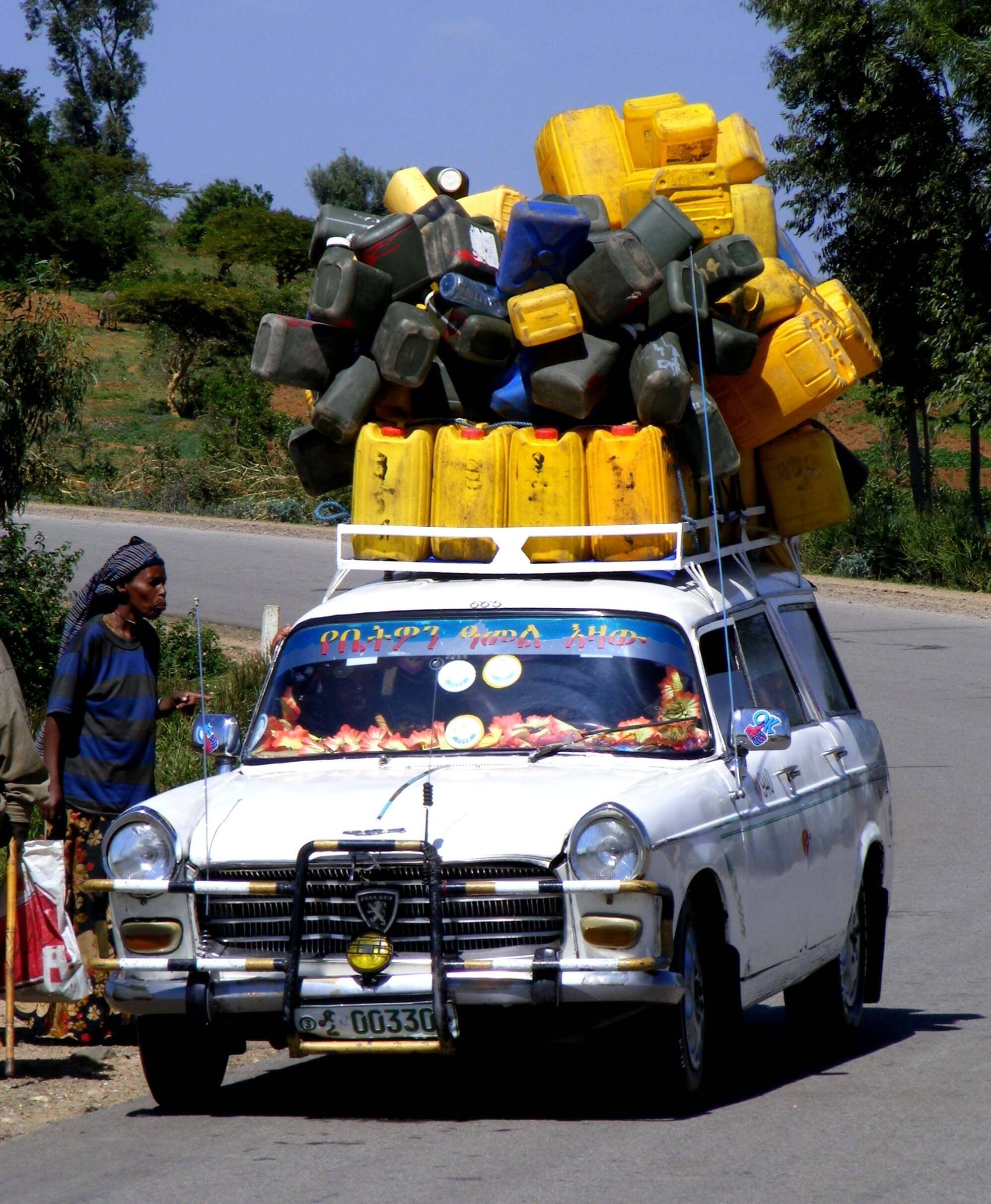 loaded car, transport, jerrycan, yellow, Ethiopia