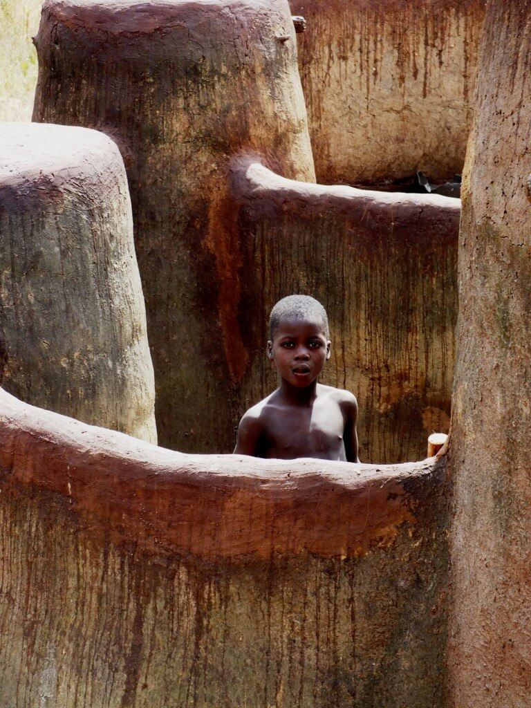 Togo, Otammari, Tamberma, Tamariba, Somba,  Mud house, traditional, boy,